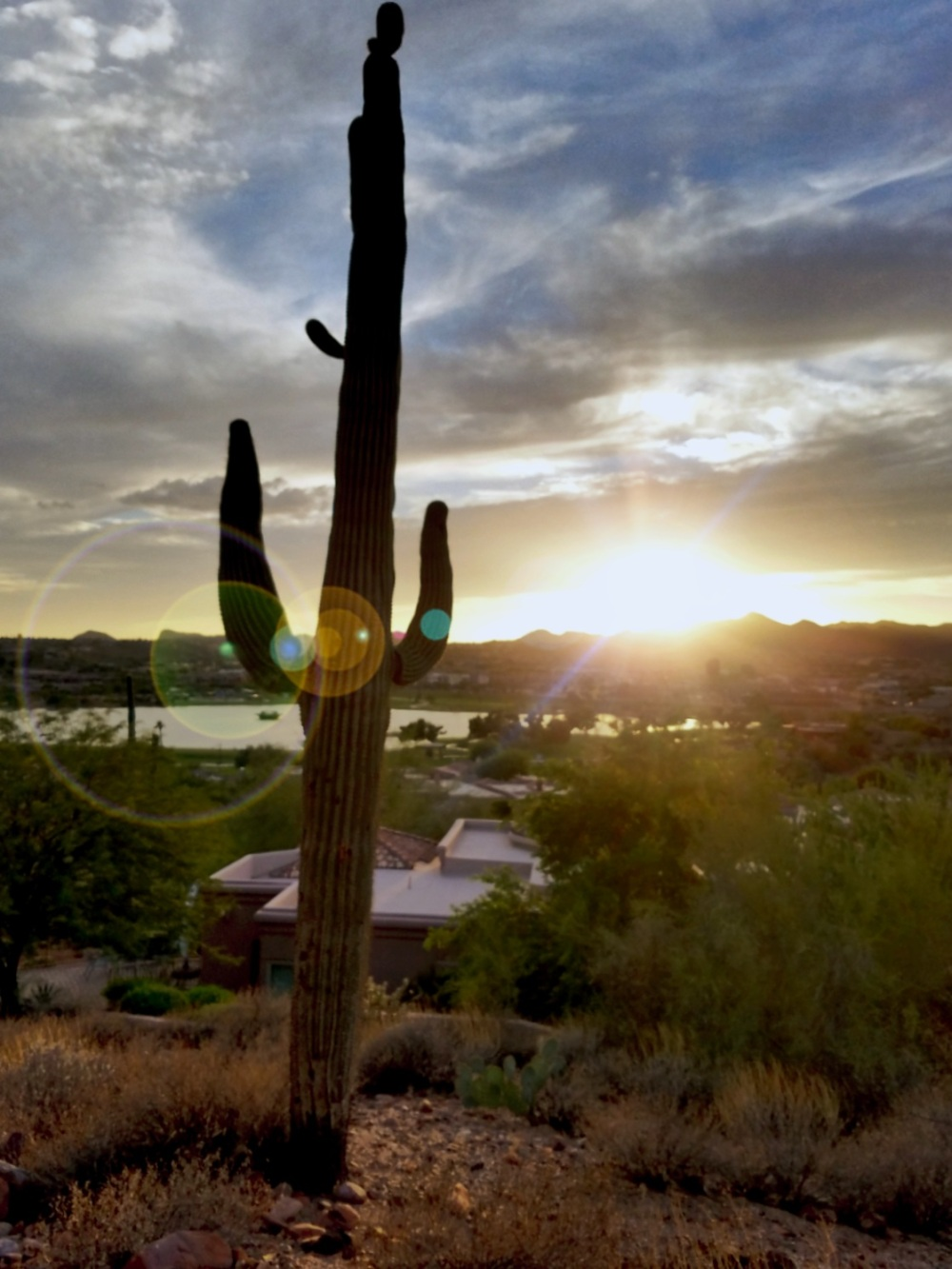 View of the sun setting behind the McDowell Mountains from Lake Overlook Trail in Fountain Hills, Arizona