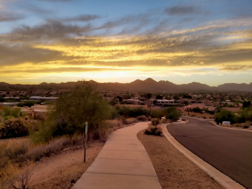 Sunset over the McDowell Mountains from the junction of Lake Overlook Trail and La Montana Dr in Fountain Hills, Arizona