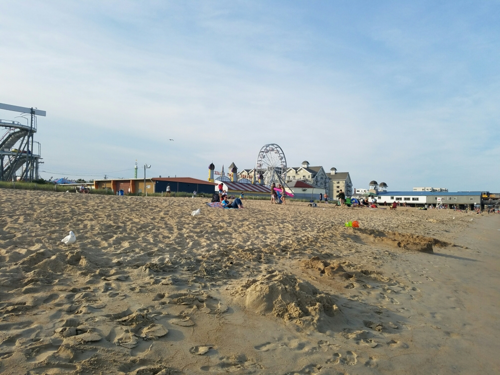 A beachfront amusement park provides entertainment for families vacationing in the area